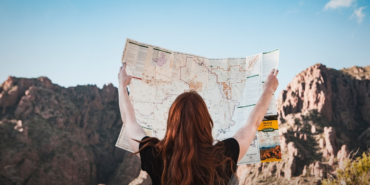Top 3 tips for working when travelling abroad with a woman and a map